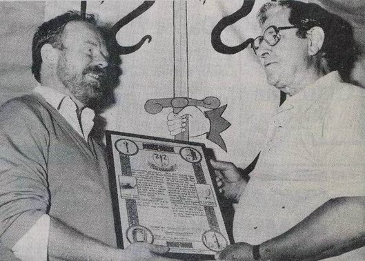 """Rísteárd Ua Cronín, Historian of the O'Dea Clan, presents the Certificate of Authority to Mr. John B. O'Day, Junior, who was the first O'Dea Chieftain elected since the 17th century by members of the clan from all over the world.""   ( Photo and caption from The Clare Champion, July 13, 1990.)"